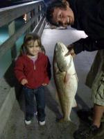 "Click to enlarge image Jeremiah Gerhard and Mia Gerhard.... the fish is as big as she is... 48"" red was caught and released. - Gerhard Family Fishing -"